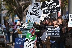 Protests Against Planned Parenthood Rouse Dueling Rallies...