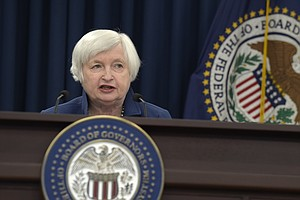 Federal Reserve Raises Key Interest Rate, Signals 2 More Increases This Year