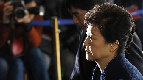 South Korea's ex-leader Park Geun-hye arrives at the prosecutor's office for questioning, in Seoul, on March 21, where she apologized to the people for her role in the corruption scandal that led to her impeachment.