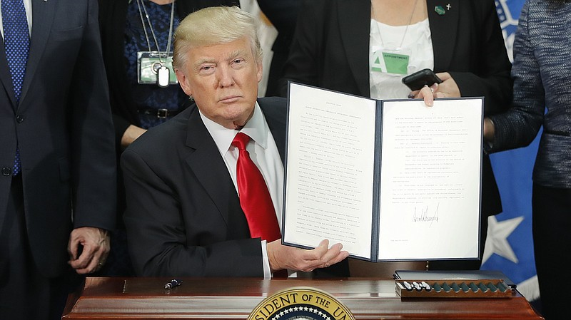 President Trump signs an executive order on immigration enforcement and sanct...