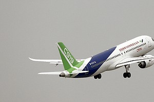 Chinese-Made Passenger Jet Takes Off For Its First Test F...
