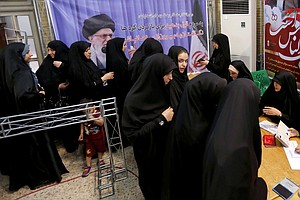 On Election Day, Iran Chooses Between Gradual Reform And ...