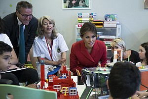 First Lady's Day in Paris Includes Children's Hospital, Church And An Awkward...