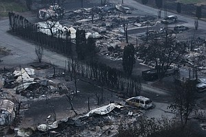 Wildfires Rage Through British Columbia, Forcing 40,000 F...
