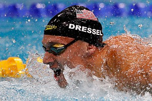 With 7 Golds, Caeleb Dressel Ties Phelps' Record At Swimm...