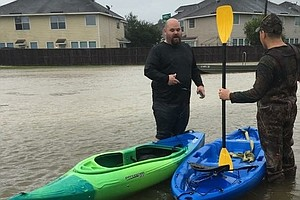 A School Counselor Takes To The Floodwaters To Rescue His...