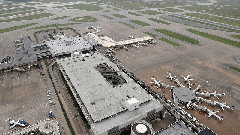 Planes are parked at George Bush Intercontinental Airport in Houston on Tuesd...