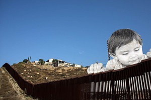 As Boy Peers Curiously Over Border Wall, His Artist Asks: 'What Is He Thinking?'