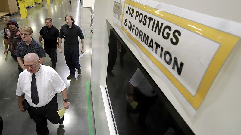 Job candidates take a tour of the Amazon fulfillment center in Robbinsville, ...
