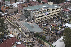 Hope, Despair Descend On Quake-Shattered School In Mexico...
