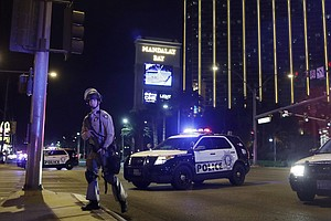 Las Vegas Gunman Shot Security Guard Before Firing Into C...