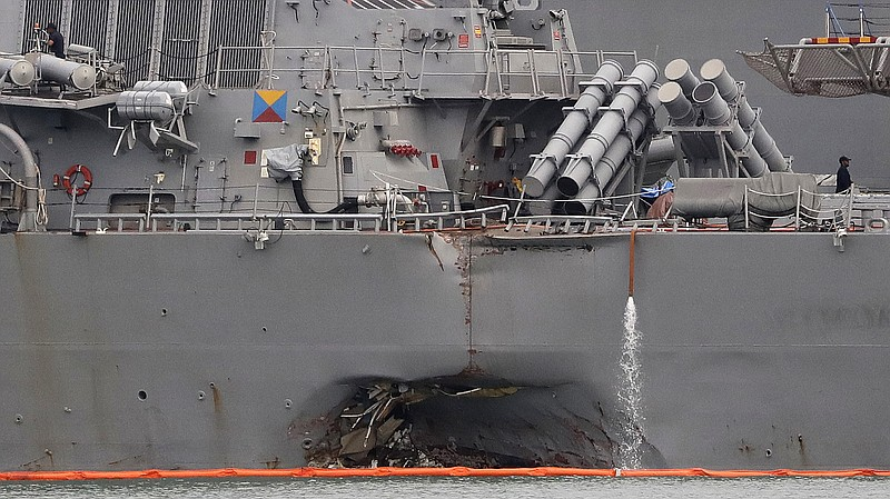 The USS John S. McCain, shown docked in Singapore on Aug. 22, was damaged aft...