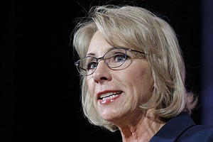 DeVos Comments On LGBT Rules; Her Husband's Political Con...