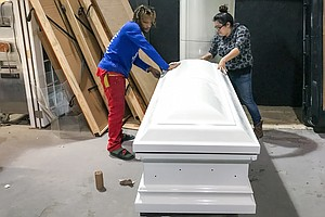 With Shiny Pink And Camo, Casket Designer Honors Texas Sh...