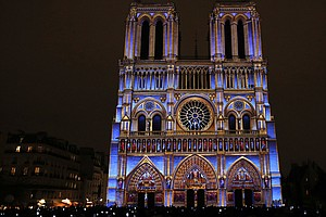 Spectacular Light Show At Notre Dame Cathedral Commemorat...