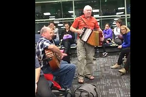 WATCH: Their Flight Was Delayed. So, They Broke Out An Accordion And Partied
