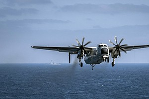 Search Continues For Missing Sailors After Navy Plane Cra...