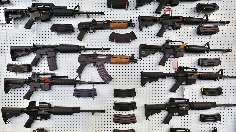 Guns are displayed at Dragonman's, an arms seller east of Colorado Springs, C...