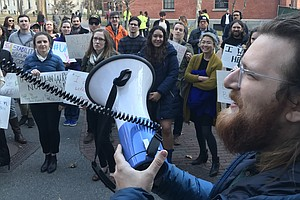 University Graduate Students Walk Out To Protest Tax Plan...