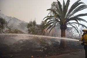 Southern California Fire Forces New Evacuations, Threaten...