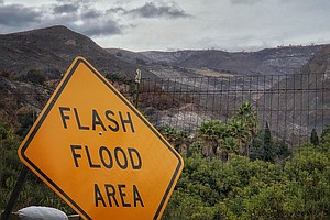 Thousands Evacuate In Southern California As Mudslides Tu...