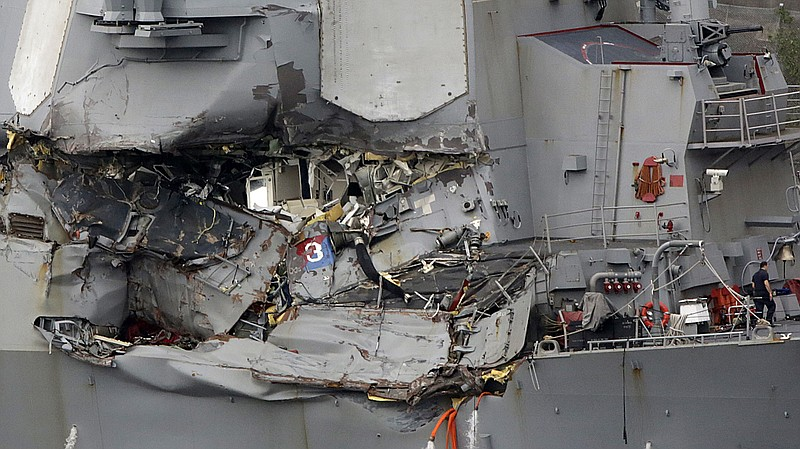 The damaged section of the USS Fitzgerald is seen at the U.S. naval base in Y...