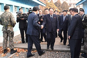 North Korean Athletes Will March With South Koreans At Py...