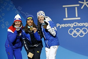Winter Olympics Kick Off With Biting Winds And History-Ma...