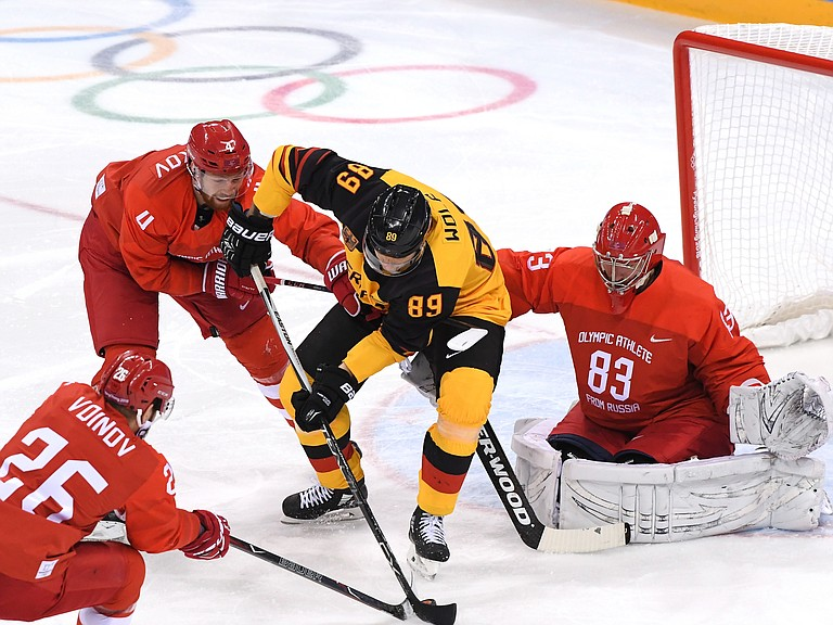 David Wolf #89 of Germany attempts a shot against Vasili Koshechkin #83 of Olympic Athlete from Russia in the first period during the Men's Gold Medal Game.