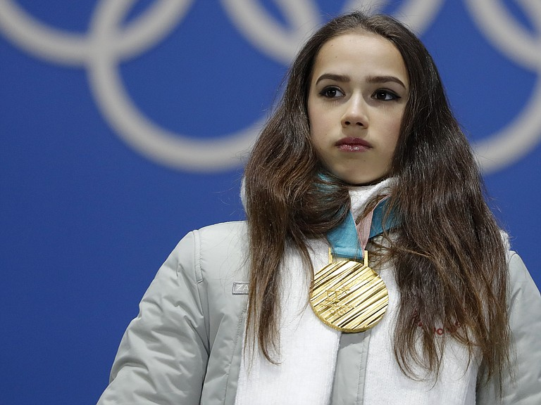 Gold medalist figure skater Alina Zagitova, an Olympic Athlete from Russia, heard the Olympics' anthem as she stood on the podium for her medal ceremony.
