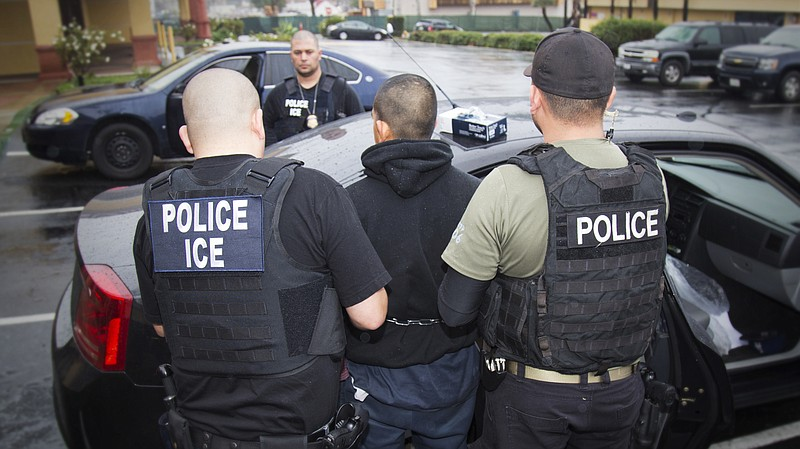 U.S. Immigration and Customs Enforcement make an arrest in Los Angeles, Feb. ...