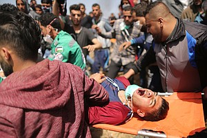 PHOTOS: Gazans Protest Again; Palestinian Officials Say 7...