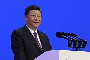 Xi Says China To Lower Trade Barriers As Beijing Files WT...