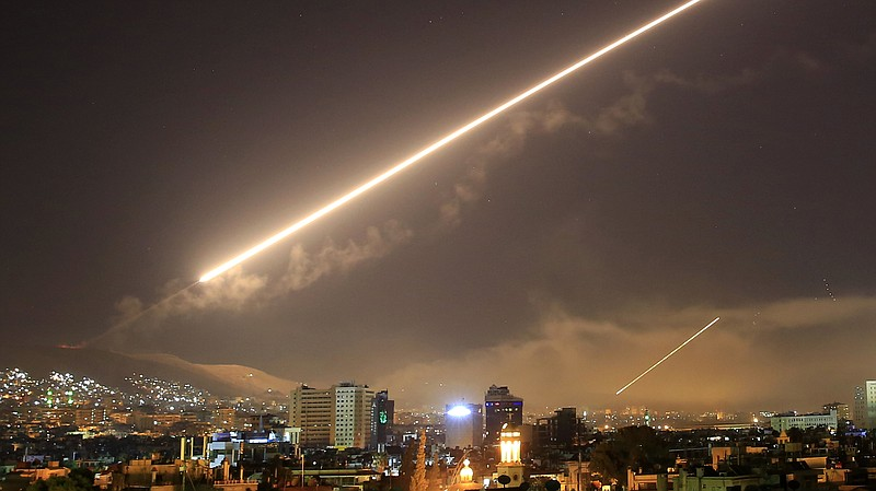 A surface-to-air missile lit up the sky in Damascus early Saturday morning af...