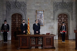 In Catalonia, A Secessionist Takes Office And A Standoff ...