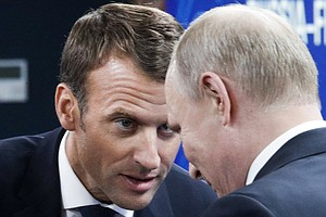 In Russia, France's Macron Tries His Next Charm Offensive...