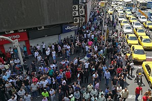 In Tehran, Economic Protests Flare As Iran's Currency Plu...