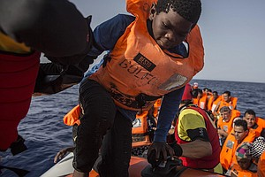 Migrant Rescue Boat To Dock In Spain After Being Rejected...