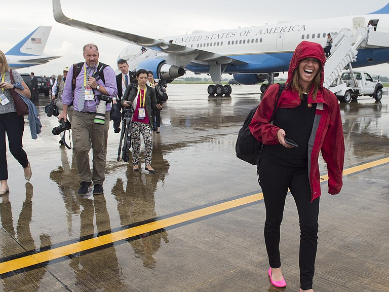 Beck Dorey-Stein, a former White House stenographer, walks with members of the White House press pool from Air Force One upon arrival at Wattay International Airport in Laos on Sept. 7, 2016.