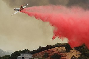 Firefighters Making Tentative Progress Against Deadly Cal...