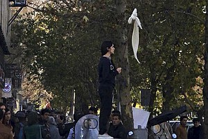 In Iran Protests, Women Stand Up, Lift Their Hijab, For T...