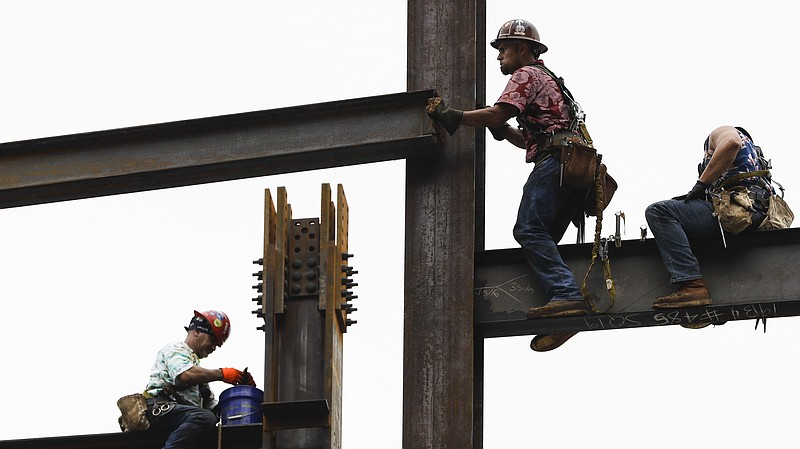 Ironworkers construct a commercial and residential building in Philadelphia, ...