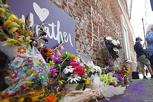 'We Are Resilient': Memorials, Heavy Police Presence Mark...