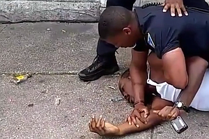 Baltimore Officer Resigns After Video Shows Him Repeatedl...