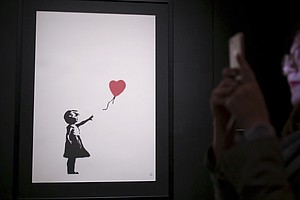 'We Just Got Banksy-ed': 'Girl With Balloon' Sells For $1.4M Before Self-Dest...