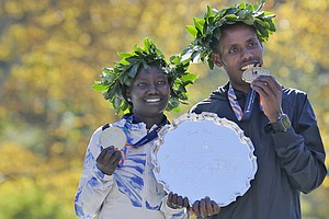 Kenya's Mary Keitany And Lelisa Desisa Of Ethiopia Win Ne...