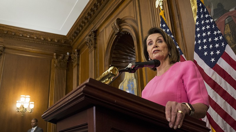 Photo caption: House Minority Leader Nancy Pelosi, D-Calif. holds a news conference followin...