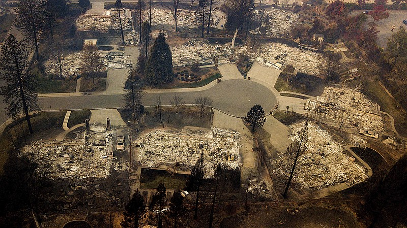 Residences leveled by the Camp Fire line a cul-de-sac in Paradise, Calif., No...