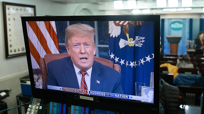 President Trump appears on a monitor in the Press Briefing Room of the White ...
