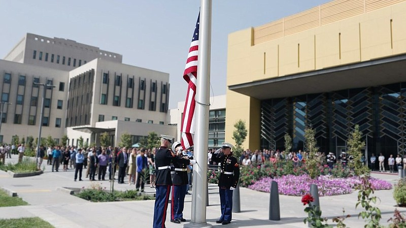 Marine guards at the Sept. 11, 2017, flag ceremony in the U.S. Embassy compou...